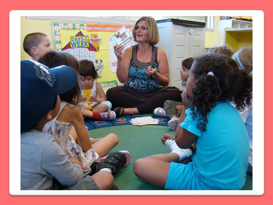 Ms. Michelle reading to children sitting in a circle