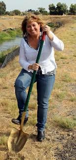 image of Diane Burgis with foot on shovel.