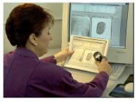 Women looking at fingerprint