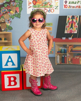 Little Girl posing with ABC Blocks